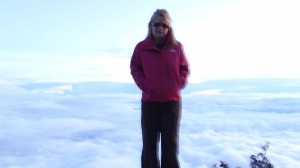 Sick from the altitude, swollen face, pounding head, but needed a photo at the top, above the clouds